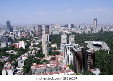 Skyline of the financial center of Mexico City. On the right Torre Mayor, the highest skyscraper in Latin America, below it is Museo Rufino Tamayo in Chapultepec Park.