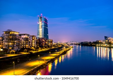 The skyline of Frankfurt, Germany, with the European Central Bank tower at night - All logos and brands removed.