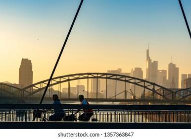 Skyline of Frankfurt at main at sunset behind bridges