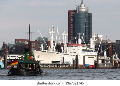 "Skyline of Hamburg with historic steamboat ""Tiger"" and museum ship ""Cap San Diego"" in the foreground"