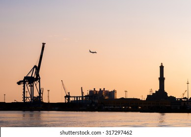 Skyline of harbor of Genoa during the sunset