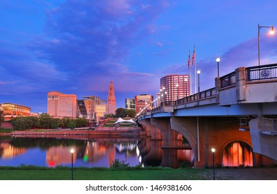 The skyline of Hartford, Connecticut before sunrise. Photo shows Founders Bridge and Connecticut River. Hartford is the capital of Connecticut.