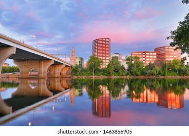 The skyline of Hartford, Connecticut at sunrise. Photo shows Founders Bridge and Connecticut River. Hartford is the capital of Connecticut.