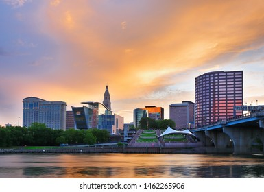 The skyline of Hartford, Connecticut at sunset. Photo shows Founders Bridge and Connecticut River. Hartford is the capital of Connecticut.
