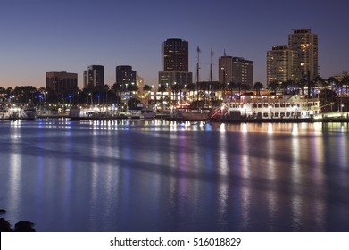 Skyline of hotels, skyscrapers, marina and harbour in Long Beach California illuminated at night