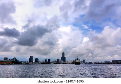 The skyline of Kaohsiung city and port under a dramatic sky