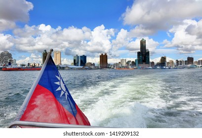 The skyline of Kaohsiung City in Taiwan seen from a boat