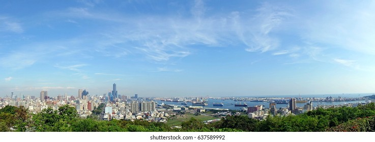 The skyline of Kaohsiung City in Taiwan and a view of the harbor seen from Longevity Hill