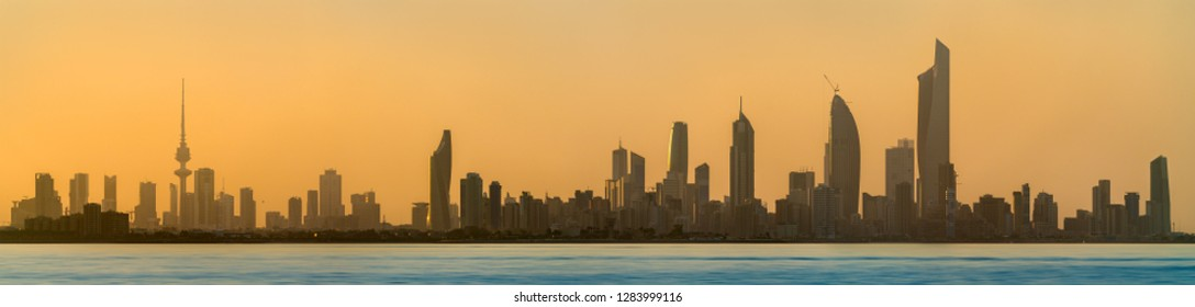 Skyline of Kuwait City at sunset. The capital of Kuwait, the Persian Gulf region