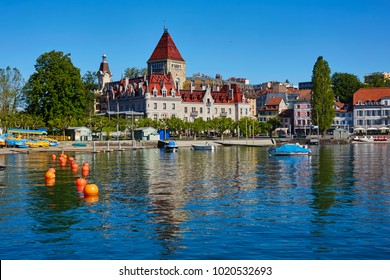 Skyline of Lausanne and the shoreline of Lake Geneva with 'Chateau de Ouchy' luxury hotel