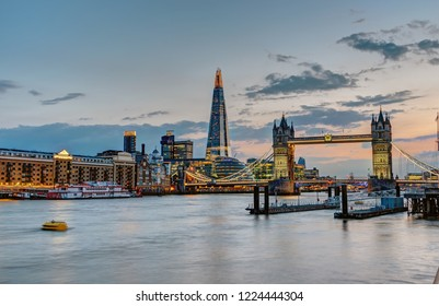 The skyline of London with the Tower Bridge and the Shard after sunset, UK
