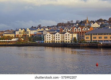 Skyline of Londonderry / Derry on the shoreline of the River Foyle at sunset