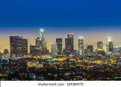 skyline of Los Angeles by night with blue dark sky