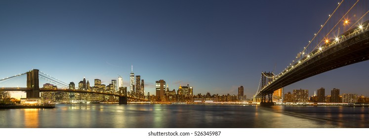 Skyline of Lower Manhattan with Brooklyn Bridge and Manhattan Bridge in the evening