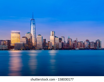 Skyline of lower Manhattan of New York City from Exchange Place at night with World Trade Center at full height of 1776 feet May 2013