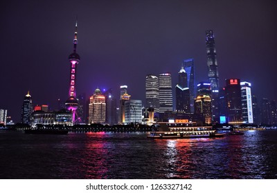 Skyline of Lujiazui Finance and Trade Zone reflected in Huangpu River. Shanghai. China. City is modern and vibrant business center and major tourist destination in China. Photo taken 2018-05-28.
