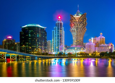 skyline of macau by the sea at night in china