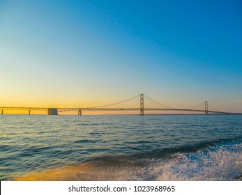 Skyline of Mackinac Bridge at sunset in Michigan, USA. This is a long steel suspension bridge located in the Great lakes region. It is one of the most famous landmarks of North America.