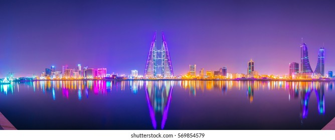 Skyline of Manama dominated by the World trade Center building during night, Bahrain.