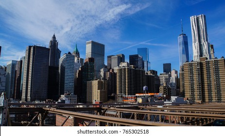 Skyline of Manhattan in New York City from Brooklyn Bridge in the afternoon