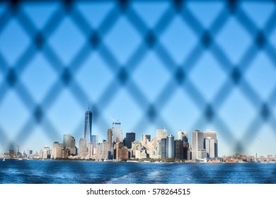 Skyline Manhattan view through the fence from ferry