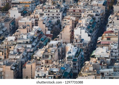 Skyline with mass of houses, buildings, apartments, rooftops in the city center of Greek capital - concept urban development town planning structure living condition. Athens, Greece