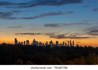 Skyline of Melbourne Australia at dusk, looking west from the eastern suburbs on Yarra Boulevard in Kew.