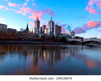The skyline of Melbourne and the Princess Bridge at dusk. Photographed from the Southbank Promenade along the Yarra River.