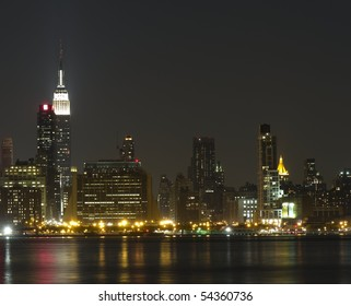 The skyline of midtown Manhattan including the Empire State Building viewed from across the Hudson River
