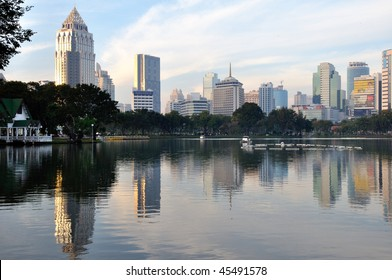 Skyline mirroring in the lake of Lumpini Park