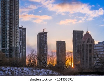 Skyline in Mississauga, Ontario near Square One showing modern architecture and real estate development in the GTA area with Sunset in the backdrop