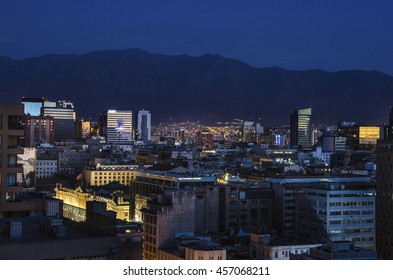 The skyline of modern buildings in Santiago de Chile by night.