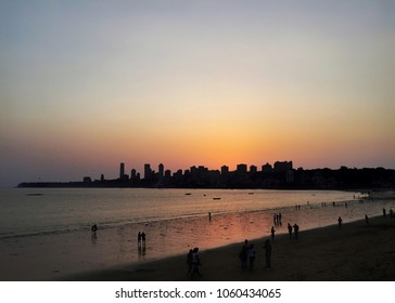 Skyline of Mumbai as visible from Marine Drive, Charni Road, Mumbai (Maharashtra, India) during sunset (summer time)