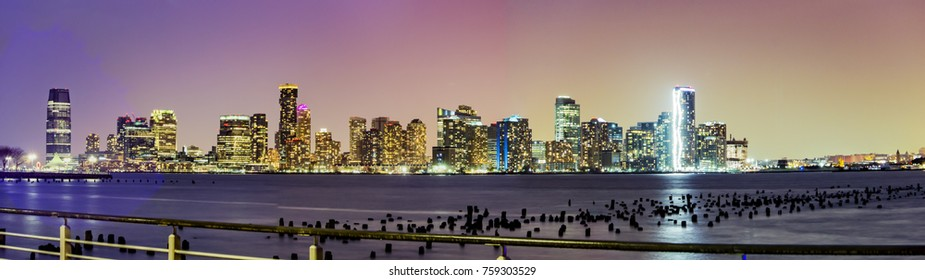 Skyline of New Jersey at night as seen from lower Manhattan across the Hudson river.