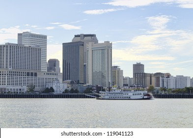 Skyline of New Orleans,  Louisiana. Paddlewheel steamboat in foreground.