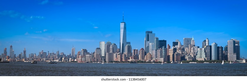 The skyline of New York City on a hot summer day from the Upper Bay from a ferry.