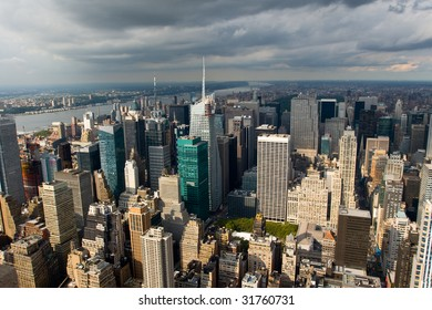 Skyline of New York City under the sun when the rain is coming.