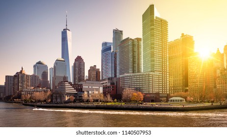 The skyline of New York city in the USA at sunrise showcasing the architecture of Lower Manhattan with its endless skyscrapers.