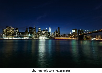 Skyline of New York at night - view of Brooklyn Bridge and Manhattan