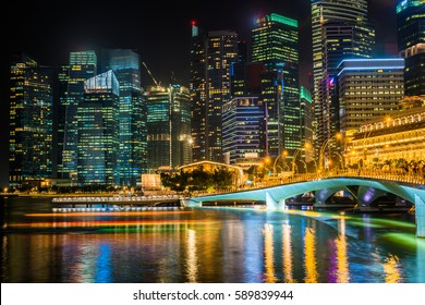 skyline at Night Lights ,City at night , Downtown reflected in water , singapore