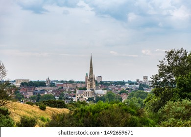 Skyline of Norwich in East England on a cloudy day, with both cathedrals and the castle to be recognised.