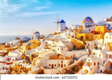 Skyline of Oia, traditional white architecture with windmills, greek village of Santorini, Greece. Santorini is island in Aegean sea, famous summer resort.