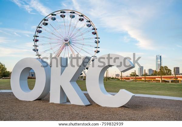 Skyline of Oklahoma City, OK with OKC sign and ferris wheel