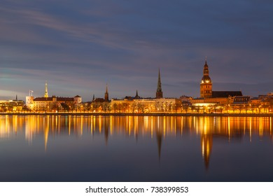 Skyline of old town of Riga seen across the river Daugava at night.