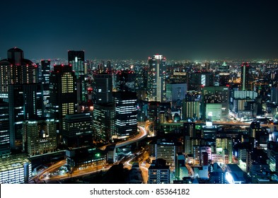 Skyline of Osaka City in Japan at night with lots of lights