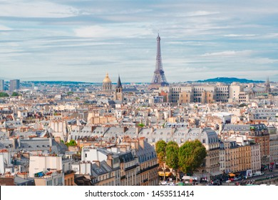 skyline of Paris city with famous eiffel tower from above in soft morning light with cloudscape, France
