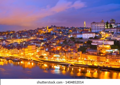 Skyline of Porto illuminated old town at twilights, Douro river, Portugal