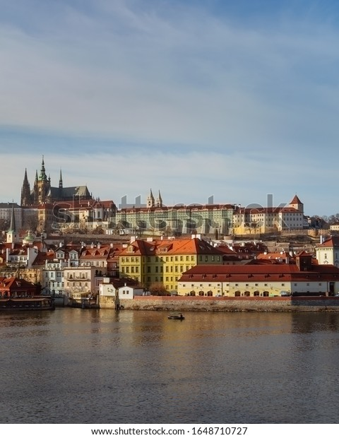 The Skyline of Prague from Charles Bridge on a cold winter morning with bright sunshine
