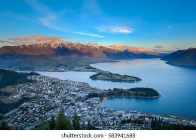 Skyline of Queenstown city and Remarkable mountain range of New Zealand during sunset, shot at Bob's Peak