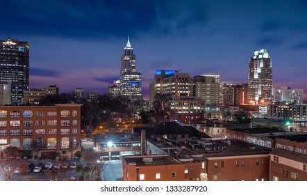 The skyline of Raleigh during a colorful sunset
